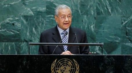 Mahathir stands by Kashmir stance despite India's palm oil boycott