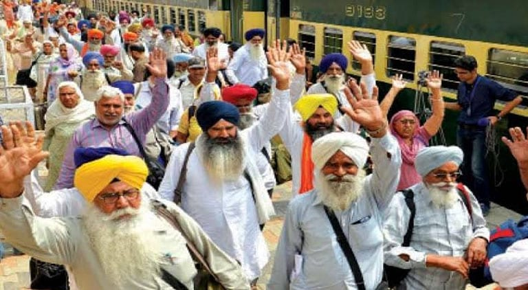 kartarpur corridor: Sikh pilgrims arrive in Lahore from India