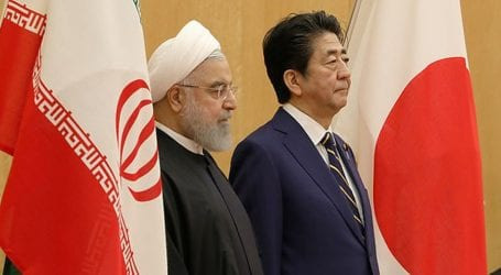 Rouhani seeks support for Iran economy on Japan visit