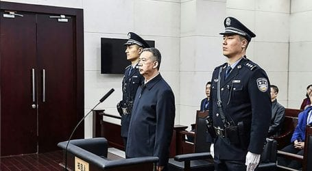 China sentences former Interpol chief to 13 years in prison