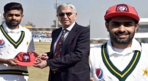Babar Azam receives his ICC ODI team of 2019 cap from Majid Khan