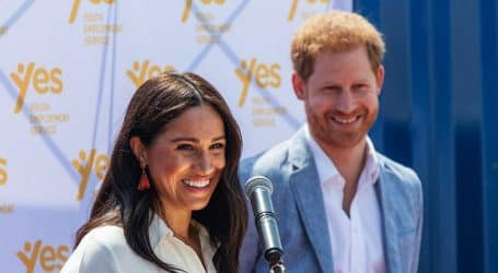 Prince Harry, Meghan Markle hand out meals to needy