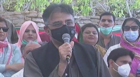 Asad Umar warns coronavirus reduced but risk still alive