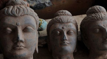 Four held in KP for destroying ancient Buddha statue