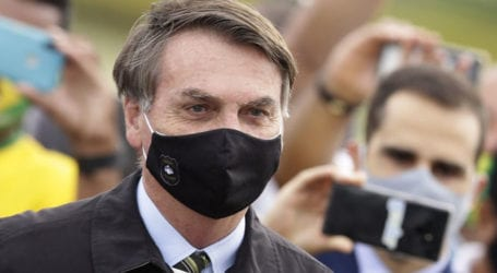 Journalists quarantined after interviewing Brazil's president