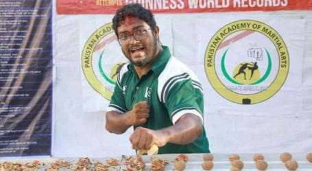 Pakistani martial artist breaks record of crushing walnuts with forehead