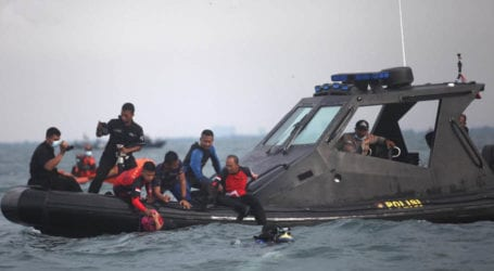 Divers recover 'black box' from crashed Indonesian aircraft