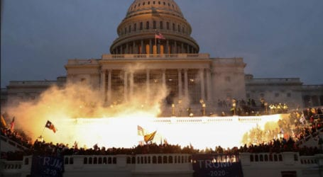 US Congress reconvenes to certify Biden win after mobs invade Capitol