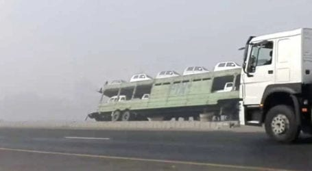 Trailer carrying imported cars overturns in Nawabshah