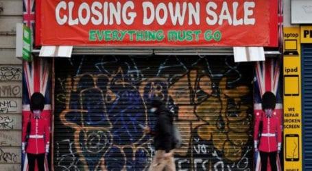 UK economy shrinks record 9.9% in 2020