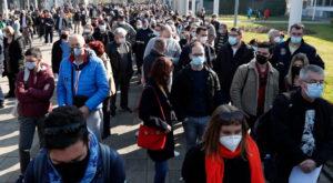 People wait to receive a dose of the AstraZeneca vaccine at Belgrade Fair makeshift vaccination centre in Belgrade, Serbia, Source: AP/ Al-Jazeera