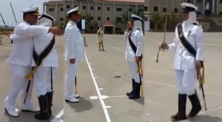 Female officer saluting uniformed father at parade receives praise