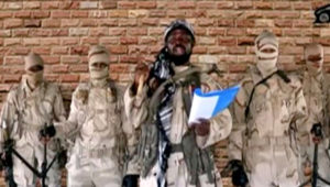 Boko Haram leader Abubakar Shekau speaks in front of guards in an unknown location in Nigeria. Source: Reuters