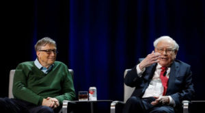 Warren Buffett, chairman and CEO of Berkshire Hathaway, speaks while Bill Gates looks on. Source: Reuters