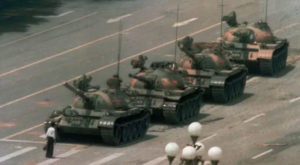 """""""Tank man"""" is often used to describe an unidentified person famously pictured standing before tanks in China's Tiananmen Square in June 1989. Source: Guardian/AP"""