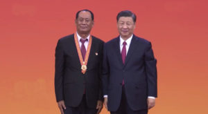 Chinese President Xi Jinping presents the July 1 Medal to one of the recipient in Beijing. Source: CGTN