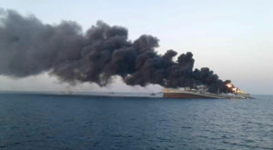 Smoke rises from Iran navy's largest ship in Jask port in the Gulf. Source: Reuters.