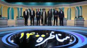 Iran's presidential candidates stand after the election debate at a television studio. Source: Reuters