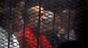 Muslim Brotherhood's senior member Mohamed El-Beltagi sits behind the bars during a court session. Source: Reuters