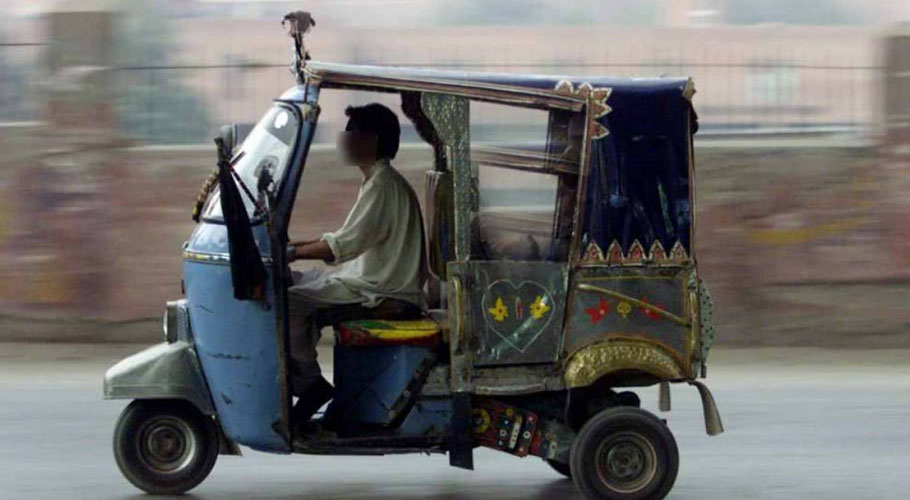 The video shows a motorcyclist hitting the rickshaw and forcing the driver to stop it at the side of the road.