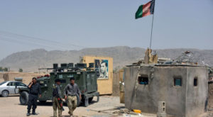 Afghan security forces inspect the site of a car bomb attack in Kandahar province. Source: Reuters