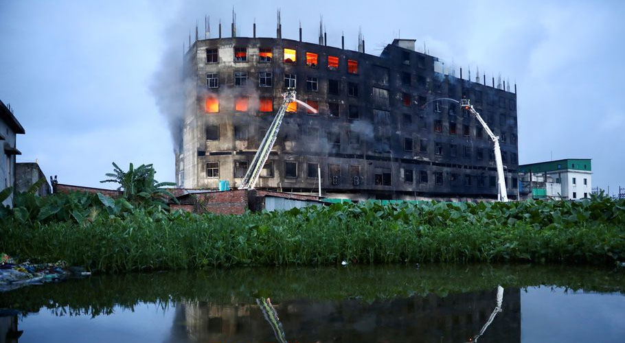 Flames rise the morning after a fire broke out at a factory on the outskirts of Dhaka. Source: Reuters.