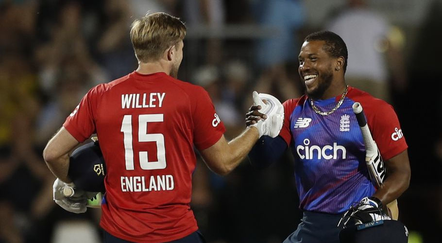 England's David Willey and Chris Jordan celebrate after winning the match. Source: FILE.
