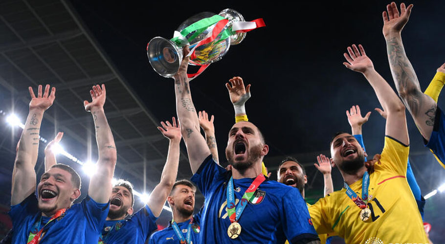 Italy celebrate with the trophy after winning Euro 2020 . Source: Reuters