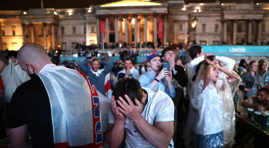 England fans react after Italy wins the Euro 2020 at Trafalgar Square. . Source: Reuters