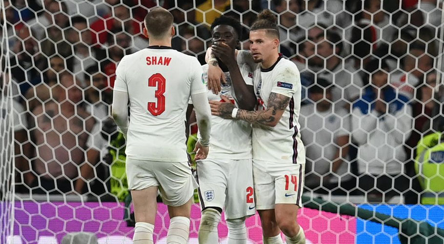 England's Bukayo Saka, Luke Shaw and Kalvin Phillips look dejected after a penalty shootout. Source: Reuters