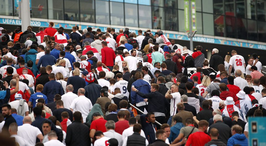 England fans with flares on Wembley way outside Wembley stadium ahead of the match. Source: Reuters