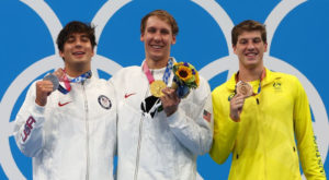 Gold medalist Chase Kalisz of the United States, silver medalist Jay Litherland of the United States and bronze medalist Brendon Smith of Australia pose on the podium. Source: Reuters.