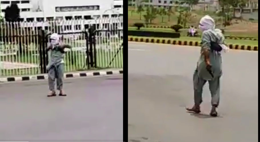 A man was roaming outside the Parliament House with a gun. Source: Twitter.