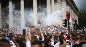 England fans with flares gather in Trafalgar Square ahead of the match. Source: Reuters